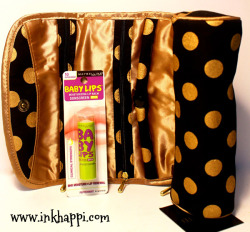 Once again... Black and Gold {{{swoon}}}. This travel case will hold your jewelry and keep it organized and protected. AND my absolute favorite lip balm! Smells great and has a hint of color.