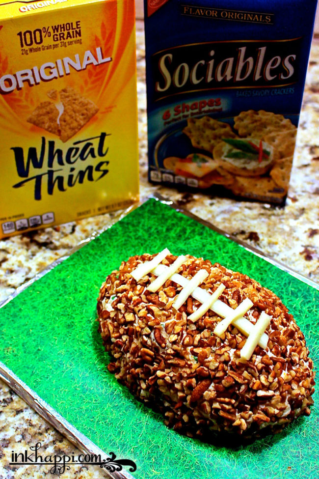 Do you want to be a hit at the party? Wether it's your own,  you're going to one or even for a tailgate party, this football cheese ball and diy grass serving tray will make everyone smile!