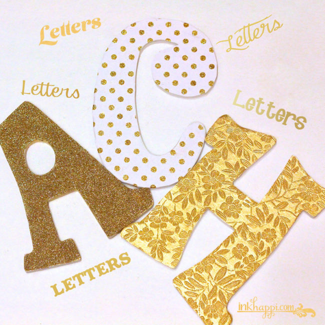 Crafting with letters... Gold glitter and textured paper letters for my studio!